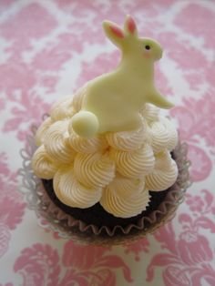 Easter Bunny Cupcake Toppers (12 Bunnies) You also top with homemade sugar cookies.and small foiled chocolate eggs.
