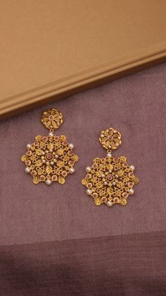Radiating ornamental fractals on the snowflake earrings are all about making a statement. Gold Jhumka Earrings, Jewelry Design Earrings, Gold Earrings Designs, Jewlery, Gold Bangles Design, Gold Jewellery Design, Pakistani Gold Jewelry, Indian Jewelry, Gold Wedding Jewelry