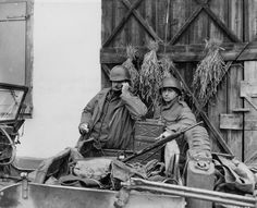 Captain Eugene Kirby of Granite Falls, North Carolina as he speaks to his platoon leaders over an SCR-300 radio on January 6, 1945. Kirby commanded a company in the 2nd Battalion, 314th Infantry Regiment, 79th Infantry Division. The photo was taken at Rohrweiler, France.