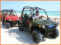 Things to do on vacation in Cozumel, Mexico - Dune buggy rides on the beach! Go to www.YourTravelVideos.com or just click on photo for home videos and much more on sites like this.