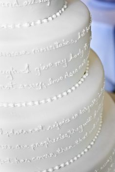 """Wedding cake with 1 Corinthians on it :) One of my favorite books of the bible! The book of Love."" I like the idea of the words on the cake. Bible verse, not so much. Maybe a chapter of Harry Potter. =)"
