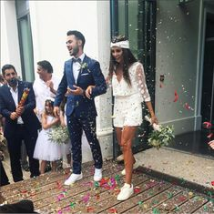 This bride represents everything - rocking a pair of sneakers & a jumpsuit on her wedding day, completely confident in her own style! Doesn't she look beautiful, happy, and really, really comfortable? Bride after my own heart. 💜☺️👏🙌 image shared via Civil Wedding Dresses, Dream Wedding Dresses, Wedding Pantsuit, Wedding Sneakers, Courthouse Wedding, Casual Wedding, Wedding Styles, The Dress, Wedding Inspiration