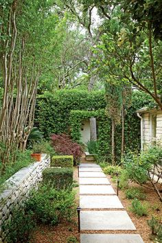 The Side Yard Hallway - Heat-Tolerant Austin Garden - Southernliving. To improve a side yard that consisted of little more than a red tile walk set into monkey grass, Yvonne and Tom turned to San Marcos garden designer Patrick Kirwin. Patrick designed a limestone path set into gravel that leads to a doorway in an arbor covered with Confederate jasmine. As with the parking area out front, the opening in the distance provides just a hint of the secret room that's just out of sight.