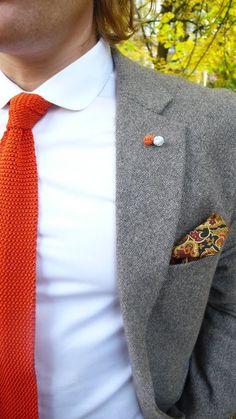 Knit tie, club collar, tweed jacket
