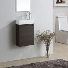 Wall hung bathroom basin sink cabinet vanity unit with a professional dark oak finish. Oak Vanity Unit, Cloakroom Vanity Unit, Basin Sink Bathroom, Vinyl Tile Flooring, Wall Hung Vanity, Small Tiles, Vanity Design, Painted Doors, Storage Spaces