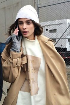 Street Style - white beanie, print cream sweat shirt and oversized camel coat #streestyle #trend