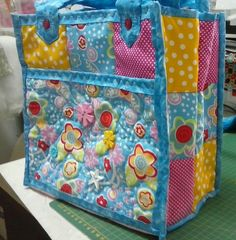 Turquoise yellow and pink quilted bag