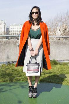 Topshop coat, La Perla slip top, Zara skirt, Alaia shoes and a bag by The Row..