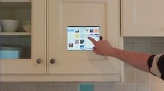 Tablet merges with kitchen cabinet- keep track of what you need to buy and when. Great for keeping and using recipes.