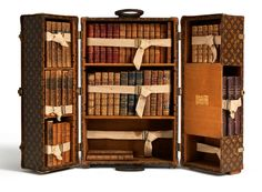 """The Louis Vuitton """"Library Trunk"""". In 1923, Louis Vuitton created a trunk for books, the use of which was not exclusive for travel but also for at home. Many well-known writers joined the bibliophiles and collectors acquiring these trunks, including Ernest Hemingway and Françoise Sagan."""