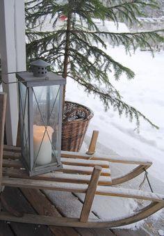 vintage sled and lantern vignette