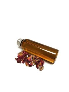 Rose Oil Infused Oil Bath Oil Body Oil by DistractedByShinies  This listing is for a 2 ounce bottle of infused oil, you pick which oil you prefer! The infusion process is done through a low and slow heat process then strained thoroughly into the bottle.   You can use this oil as a bath oil, body oil, even a massage oil!   Take care when using it as a bath oil though as it can make your tub slippery, so please be careful!