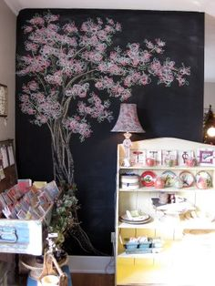 Chalkboard tree! You could make this yourself with plywood, chalkboard paint and chalk (maybe a stencil or two if you're like me and can't really draw).