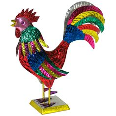 This bird has plenty to crow about! Hand cut and hand painted by Mexican metal smiths, this rooster represents an age old tradition of creating art from materials at hand. A great gift or a colorful accent for any room of your home. Only $35.30.