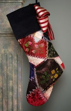 This beautiful one-of-a-kind stocking is made from a Victorian silk and velvet crazy quilt that was made in the 1885. This particular quilt was