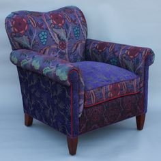 Molly Rose Chair in Concord by Mary Lynn O'Shea. The artist's own jacquard color combinations bring vibrancy and verve to her double-cloth cotton and rayon fabric. Kiln-dried hardwood frame with double doweled joints and blocked corners. Hand-tied deep seating coils tied in 8 directions. Spring-down cushions offer strength and comfort. Seat height is 19