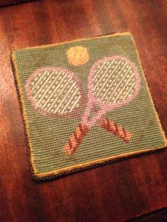 tennis coaster - in needlepoint, of course