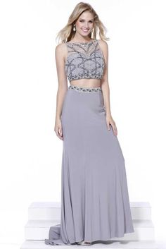 Two Piece Set Prom Gown NX8223. Sheath Shape Prom and Evening Two Piece Set Gown has Ornate Jewel and Beading Embellished Cropped, Illusion Sweetheart Bodice with Sheer Back featuring Keyhole Detail. Solid Color, Floor Length Skirt with Beaded Waistline and Sweeping Train. https://www.smcfashion.com/wholesale-prom-dresses/prom-gown-nx8223