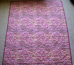 Australian Handmade Gifts - Yalke Pink Cot Quilt - $75 - https://www.highlandshandmade.com.au/yalke-pink-cot-quilt-75/ - Yalke Pink  A genuine designed Aboriginal fabric.  100% cotton front and backing fabric with lightweight wadding.  Machine quilted with heart shapes. Washable with a gentle cycle.  Suitable for a little girl. Size 128 x 108 cms  Made in the Southern Highlands of country NSW by Dennis Buck.  Time taken to make this was 6 to 8 hours.  Please not