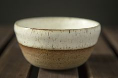 Rick Bajornas. red speckled clay. glazed inside and out in antique white