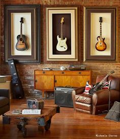 The perfect man cave for any music lover. This man cave has a brick accent wall and hardwood floors. Click the pin to see the average cost of installing new hardwood floors in your home.