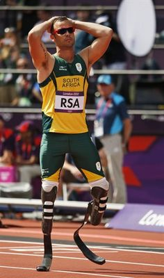 South Africa's Oscar Pistorius reacts after fellow team members crashed out of a men's 4x400-meter relay. South Africa wins their appeal and will race in the finals!!!