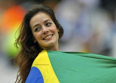 A fan waits for the 2014 World Cup Group D soccer match between Uruguay and England at the Corinthians arena in Sao Paulo June (REUTERS/Ivan Alvarado) Soccer Match, Soccer Fans, Soccer World, World Cup 2014, Fifa World Cup, World Cup Groups, Most Beautiful, Beautiful Women, Brazilian Women