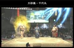 "The sumo match pictured above was a highlight of the conference. As the match was fought, a large screen behind the ring projected an enhanced version with special effects added live, including a display of HP and the Street Fighter/ Dragon Ball Z style light effects you can see in the image. The event was called, interestingly, ""real sumo"". Realer than real."