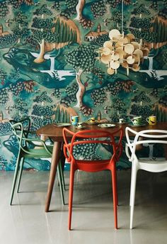 Kartell chairs are gorgeous in a multicolor display, but we especially love the wallpaper!