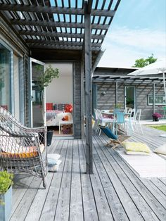 love the idea of a long porch running the length of the house