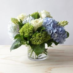Lowry Flower Arrangement is part of Blue flower arrangements The Lowry is a lush, springy, and lowfrills blend of multiple hydrangea varieties and crisp seasonal accents (Small size shown) DELI - Arrangements D'hortensia, Blue Flower Arrangements, Floral Centerpieces, Wedding Centerpieces, Wedding Decorations, Wedding Bouquets, Tall Centerpiece, Wedding Floral Arrangements, Wedding Dresses
