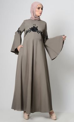A perfect wardrobe piece for everyday purpose Simple and classy abaya with round neck A stylish abaya includes embroidered front Includes both side pockets Back Zipper Bell sleeves FABRIC: Twill CARE: Machine wash with cold water Modest Wear, Modest Outfits, Alia Bhatt Cute, Black Abaya, Kaftan Style, Hijab Dress, Perfect Wardrobe, Pakistani Outfits, Vintage Vibes