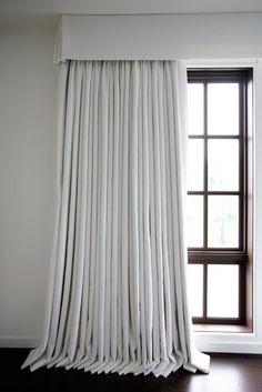 White linen curtains, flat valance with kick-pleat corners