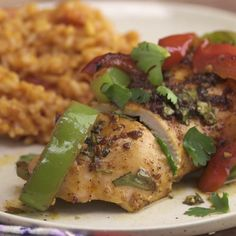 There are hundreds of chicken and rice recipes. Both ingredients do an incredible job absorbing the surrounding flavors, but for this dish, the flavors are more than just absorbed – they're rolled in. Chicken breasts marinated in garlic, olive oil, chili powder, cumin, cilantro and oregano are complemented by rice cooked with sautéed garlic, tomatoes, and chicken stock. Finally, colorful roasted peppers seasoned with fajita mix are rolled into the chicken for a bright pop of color and…