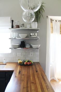 The Kitchen: Before and Afters! from chrisLOVESjulia...i just love the crispness of this kitchen!