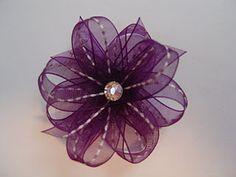 Cutie Ties!  Adorable bows & flowers that clip to interchangable headbands.