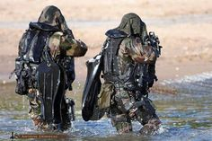 French Navy's Commandos Marine operatives emerging from the waters.