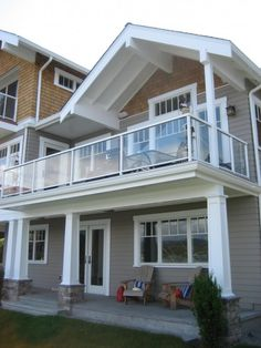 Great covered deck detail with exposed white rafters and painted beams, creating a space underneath.