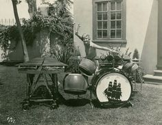 I would LOVE to know the story behind this photo - how did this enthusiastic 1920s/30s lady come to be out on the lawn with a vibraphone and drum kit with galleon painted on the bass drum, a console rack, tom toms with tacked heads, and temple blocks?  Looks like she has mallets in one hand and at least one stick in the other.
