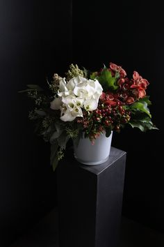 Rich shades of crimson, tawny green and pure white: 'Cranberry Spice' by Winston Flowers.