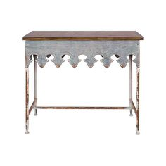 Life is a fairy tale, and sometimes a rusty one. This Fairy Tale Metal Table brings a romantic twist to a vintage décor. Its natural wood top sits over a scalloped base and bracketed legs, all with a c...  Find the Fairy Tale Metal Table, as seen in the #MarrakechModern Collection at http://dotandbo.com/collections/marrakechmodern?utm_source=pinterest&utm_medium=organic&db_sku=106002