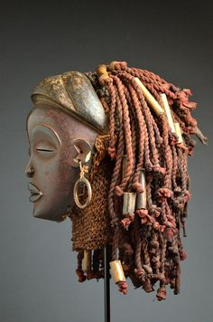 Africa | Pwo mask from the Chokwe people of Angola or DR Congo | Wood, metal, cloth, raffia and beads | ca. early to mid 20th century