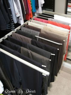 Driven By Décor: IKEA's PAX Closet System: The Good, the Bad, & the Ugly. Love the two-deep slide-out pant rack for maximum storage.