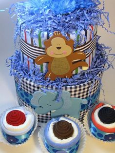 Diaper Cake:  This adorable boy diaper cake comes with matching cupcakes!