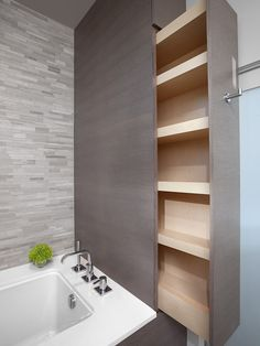 Hidden storage in a modern bathroom. Gorgeous tile selection! http://www.interiorsbystudiom.com/blog/2013/07/custom-cabinetry-bathroom-design-built-in-cabinets/