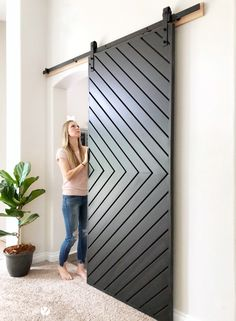 Learn how to build a gorgeous fixer upper style MODERN barn door with these easy., in 2020 Learn how to build a gorgeous fixer upper style MODERN barn door with these easy. Diy Barn Door, Barn Door Hardware, Diy Sliding Barn Door, Barn Door In Bedroom, Building A Barn Door, Door Hinges, Sliding Barn Door For Closet, Sliding Door For Bathroom, Making Barn Doors