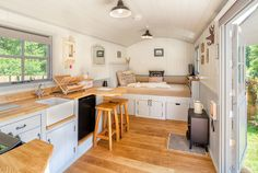 Sheperds Hut Retreat - love the kitchen layout with sink and seating area