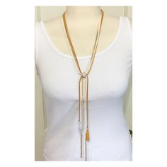 New Faux Suede and Gold Long Necklace    Color options:  Pink/Purple  Yellow/Orange  Tan/White  Turquoise/Blue- SOLD OUT    Necklace connects with a adjustable Rhinestone Loop in the center. Just move to adjust the desired hanging you prefer. Each necklace has gold stands and matching color beads at the bottom.   Shop this product here: spreesy.com/Shopmythreads/75   Shop all of our products at http://spreesy.com/Shopmythreads      Pinterest selling powered by Spreesy.com