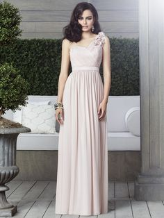 Full length one shoulder lux chiffon dress with handworked flower detail at shoulder. Draped bodice and matching matte satin inset waistband natural waist. Shirred skirt. Available with extra length. Available in 80+ colours