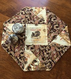This beautiful octagon Autumn quilt is great for the holidays. This quilt measures 12 from side to side. The quilt is made from premium 100% cotton fabrics. The back fabric is a beige and brown print that will work year round. The middle layer of the quilt is made of Warm and Natural cotton batting. It was handmade by me in a smoke free environment. It is machine washable, on a delicate cycle with cold water.